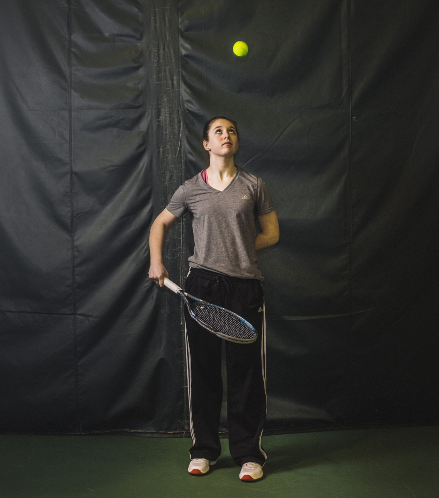 Rosemary Campanella practices Tuesday at Foreside Fitness & Tennis in Falmouth. A freshman player at Wells High School, where no varsity team exists, Campanella could play for Kennebunk, according to Maine Principals' Association rules, but her matches would be forfeits, hindering the team's score.