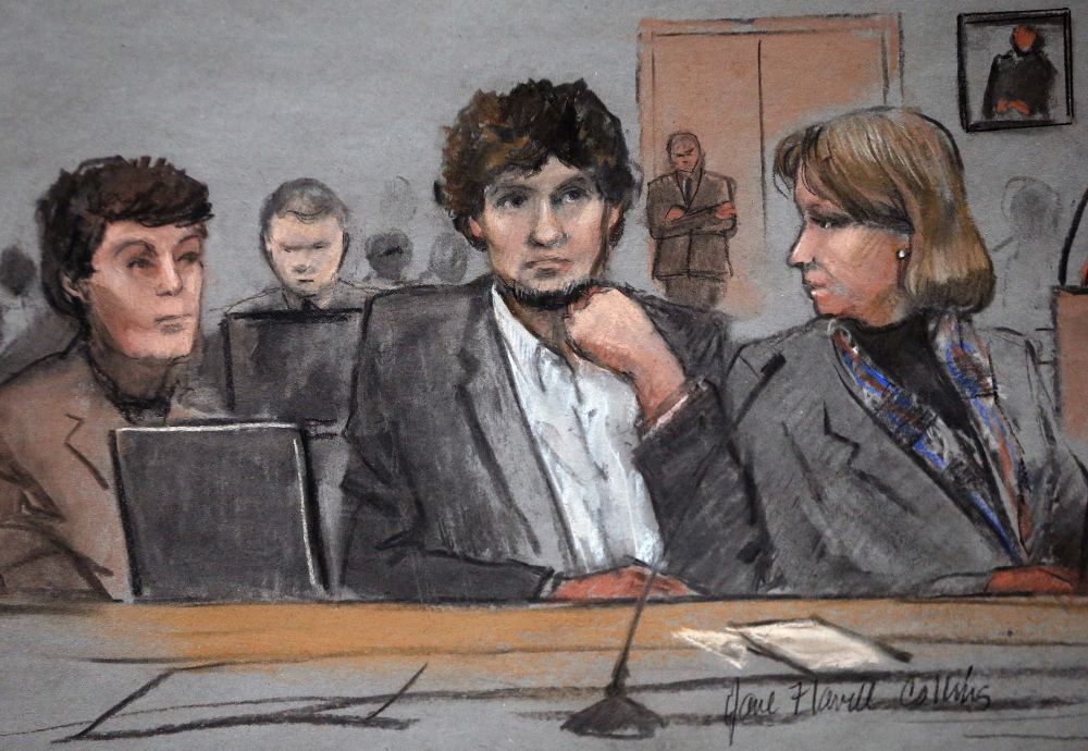 Defendant Dzhokhar Tsarnaev is depicted between defense attorneys Miriam Conrad, left, and Judy Clarke in this courtroom sketch from Thursday's trial in Boston.