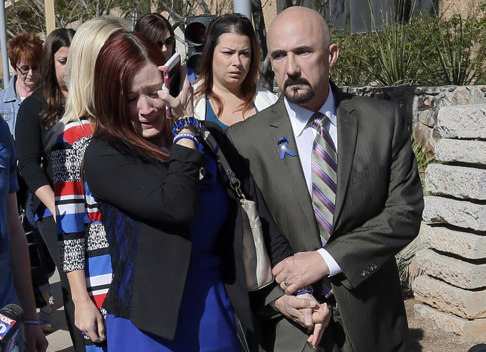 Tanisha Sorenson, sister of murder victim Travis Alexander, cries as she leaves the courthouse with family and friends Thursday in Phoenix.