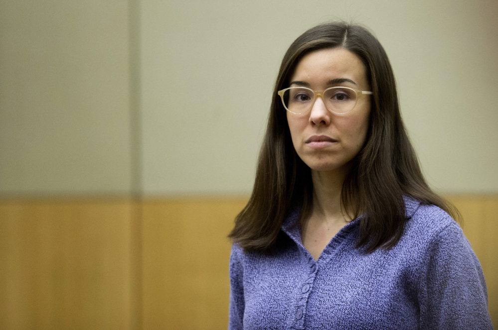 Jodi Arias stands for the jury during her sentencing retrial at Maricopa County Superior Court in Phoenix last month. Arias was spared the death penalty Thursday after jurors deadlocked on her punishment for killing her lover in 2008.