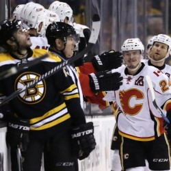 Calgary Flames left wing Jiri Hudler (24) is congratulated by teammates after his goal against the Bruins in the second period of Thursday night's game in Boston. The Flames won, 4-3, in a shootout.