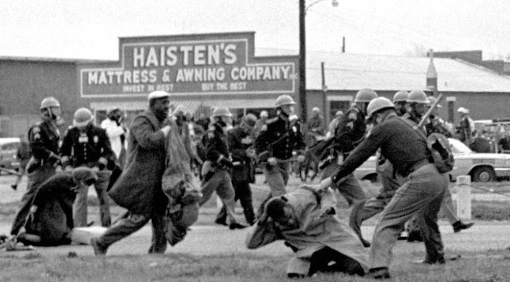 Future U.S. Rep. John Lewis, right, is roughed up by authorities while leading a voting rights march in Selma, Ala., on March 7, 1965. Now 75, Lewis will be among the many political leaders returning to Selma this weekend to celebrate the civil rights movement.