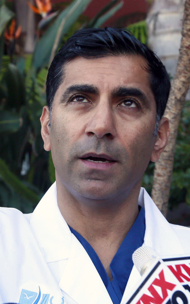 Dr. Sanjay Khurana talks to reporters at his office in Marina Del Rey, Calif., on Friday about seeing Ford's plane falling from the sky while he was on a golf course Thursday. Khurana was among the first to go to Ford's aid. The Associated Press