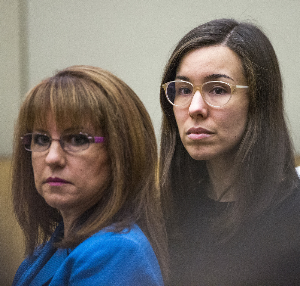 Jodi Arias, right, watches jurors enter the courtroom before hearing their verdict.