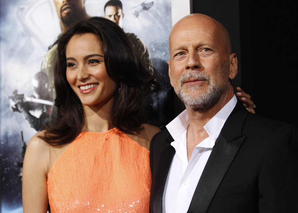 "Bruce Willis, shown with his wife, Emma Heming, will play a romance novelist in a stage adaptation of Stephen King's novel  ""Misery."""