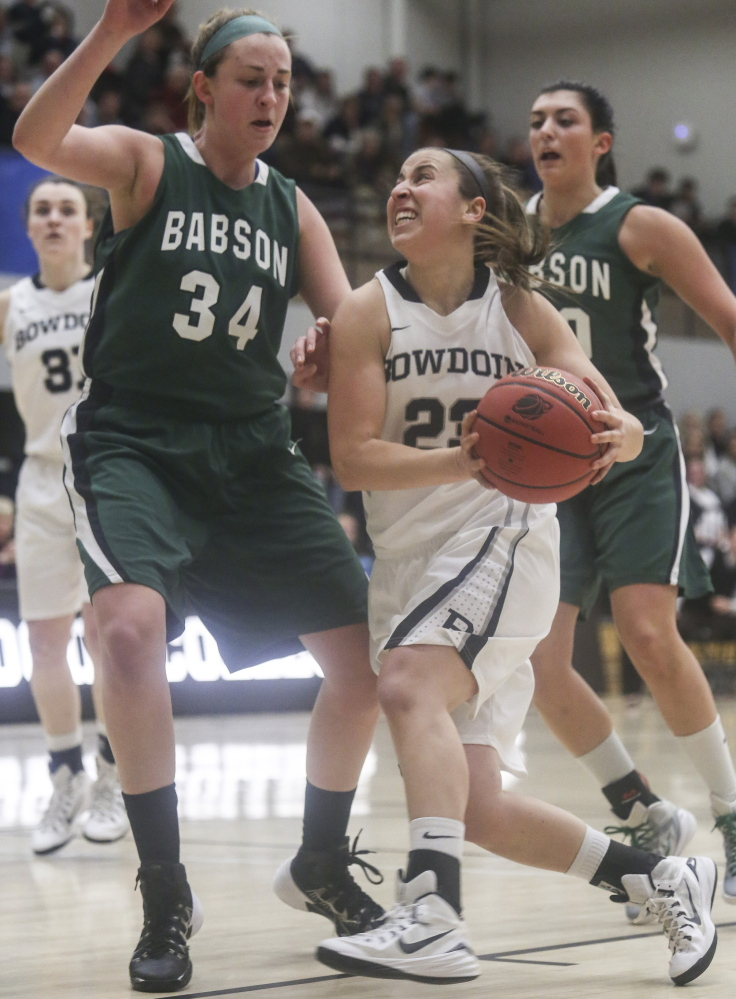 Sara Binkhorst, who had 16 of her game-high 19 points for Bowdoin in the second half, goes for a layup as Ashley Snyder, left, and Linnett Graber defend for Babson. Bowdoin moved on in the NCAA tourney, 70-57.