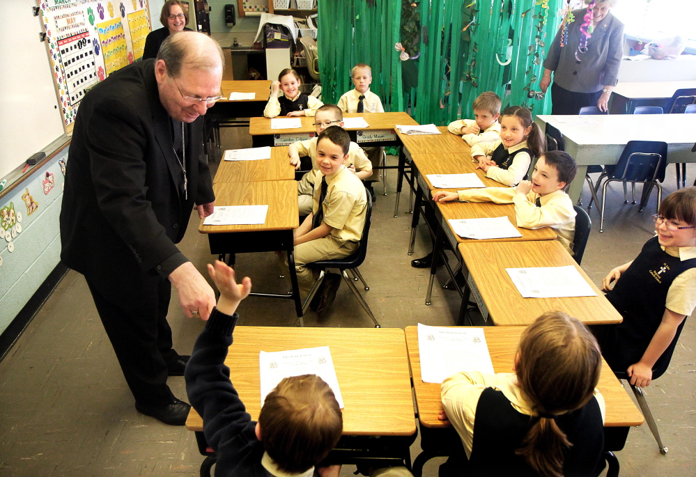 CAP.cutline_standalone:Bishop Robert Deeley of the Portland Diocese responds to a question by Nolan Kelley, lower left, while visiting with students in Lucille Nassar's second grade class at St. John Catholic School in Winslow several weeks ago. Deely this week gave final approval to a request that a seventh and eight grade be added at the school.