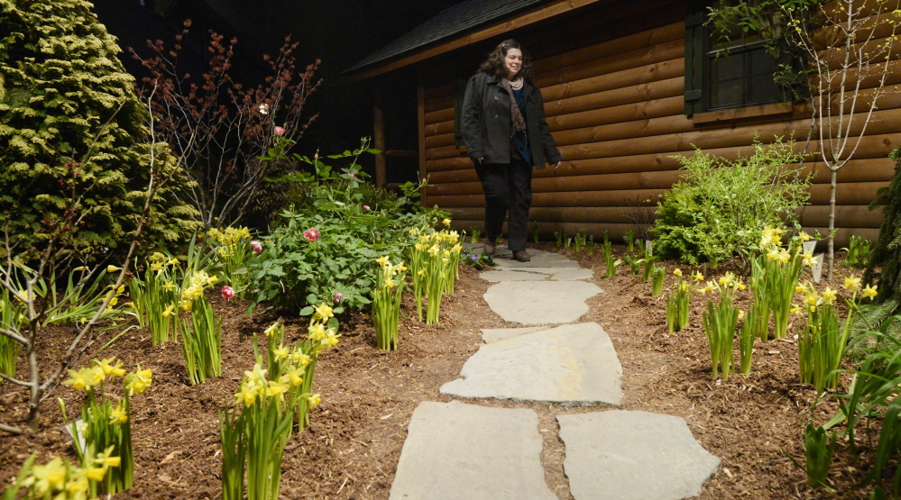 Jane Dyer of Portland navigates a stone walkway – no icy surfaces here – at the Portland Flower Show on Friday.