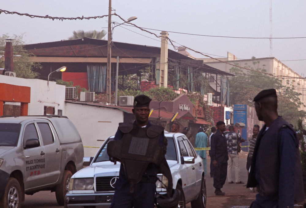At least one masked gunman sprayed bullets in a nightclub, rear, popular with foreigners in Mali's capital early Saturday.