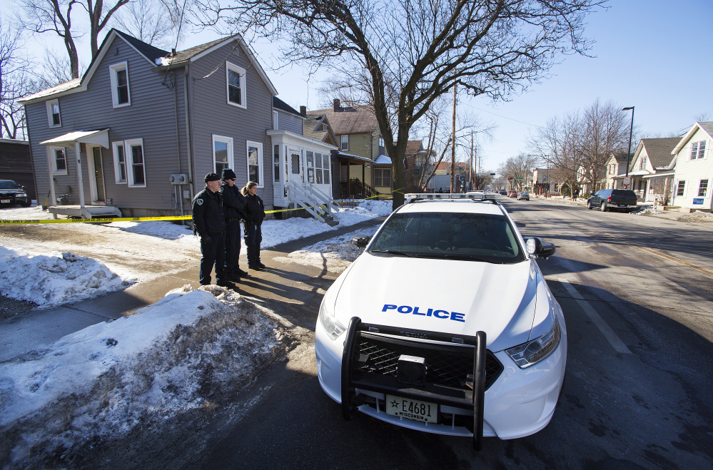 Madison Police stand outside the scene of a police involved shooting at a home in Madison, Wis., on Saturday.