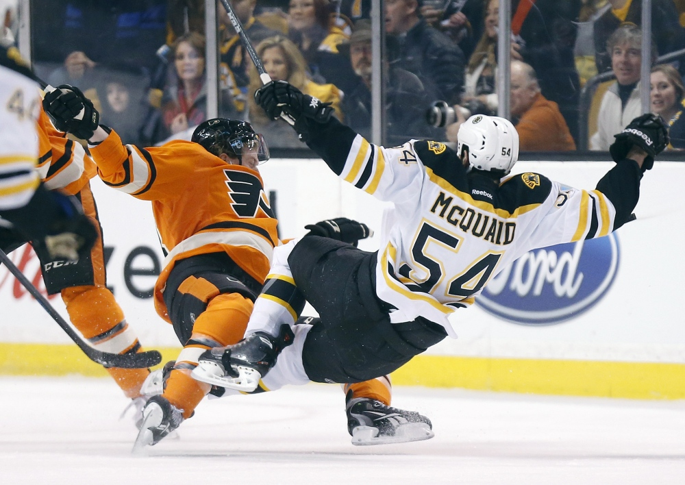 Brayden Schenn, left, of the Flyers collides with Boston's Adam McQuaid in the first period Saturday in Boston.