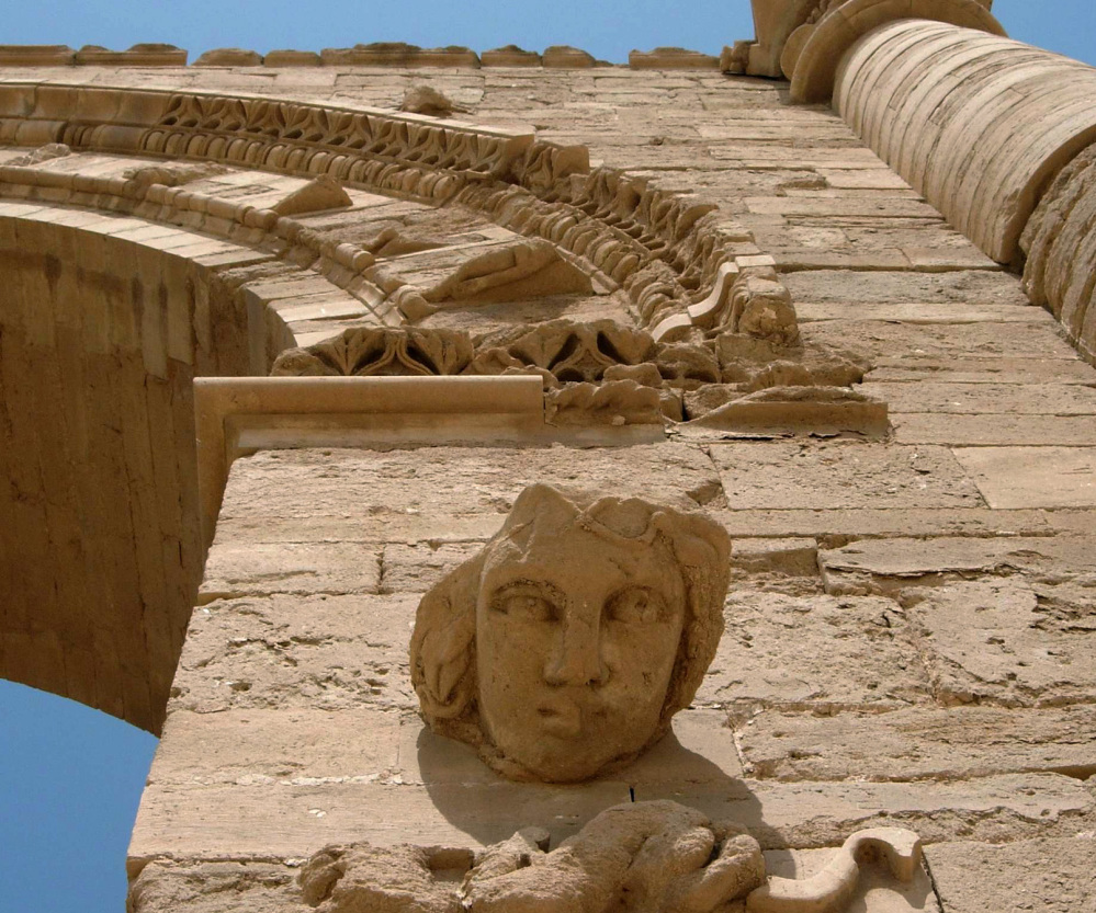 The face of a woman adorns ruins in Hatra, Iraq, which the Islamic State group looted and damaged a day after bulldozing the historic city of Nimrud.