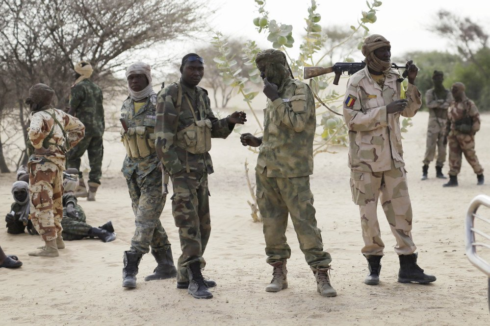 The Associated Press Chadian troops previously stationed by the Sudanese border make a stop on their way to lake Chad near Baga Sola Friday.