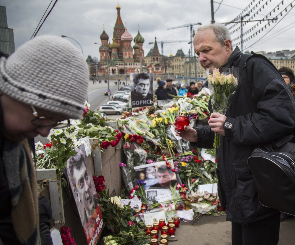 Mourners lay flowers and candles Saturday at the site in Moscow where Boris Nemtsov, a sharp critic of President Putin, was gunned down Feb. 27.