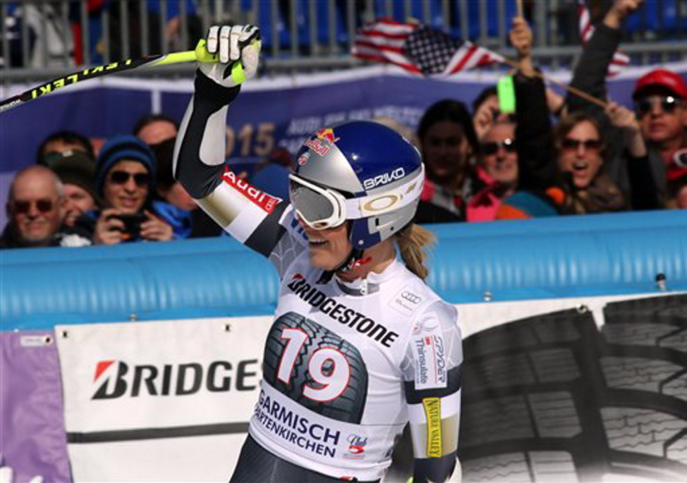 Lindsey Vonn celebrates in the finish area after completing the women's World Cup super-G, in Garmisch Partenkirchen, Germany, on Sunday. Vonn won the event.
