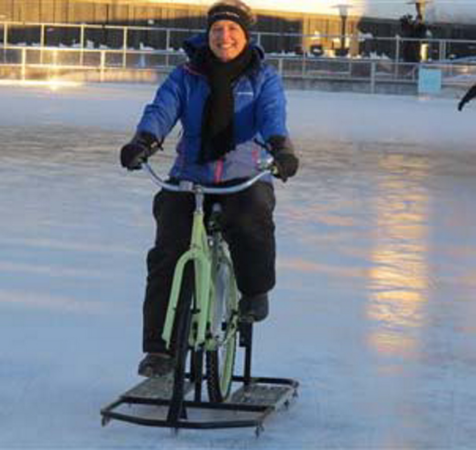 Lisa Florczak, founder of Ice Bikes of Buffalo, rides one of her inventions at the Ice at Canalside in Buffalo, N.Y.
