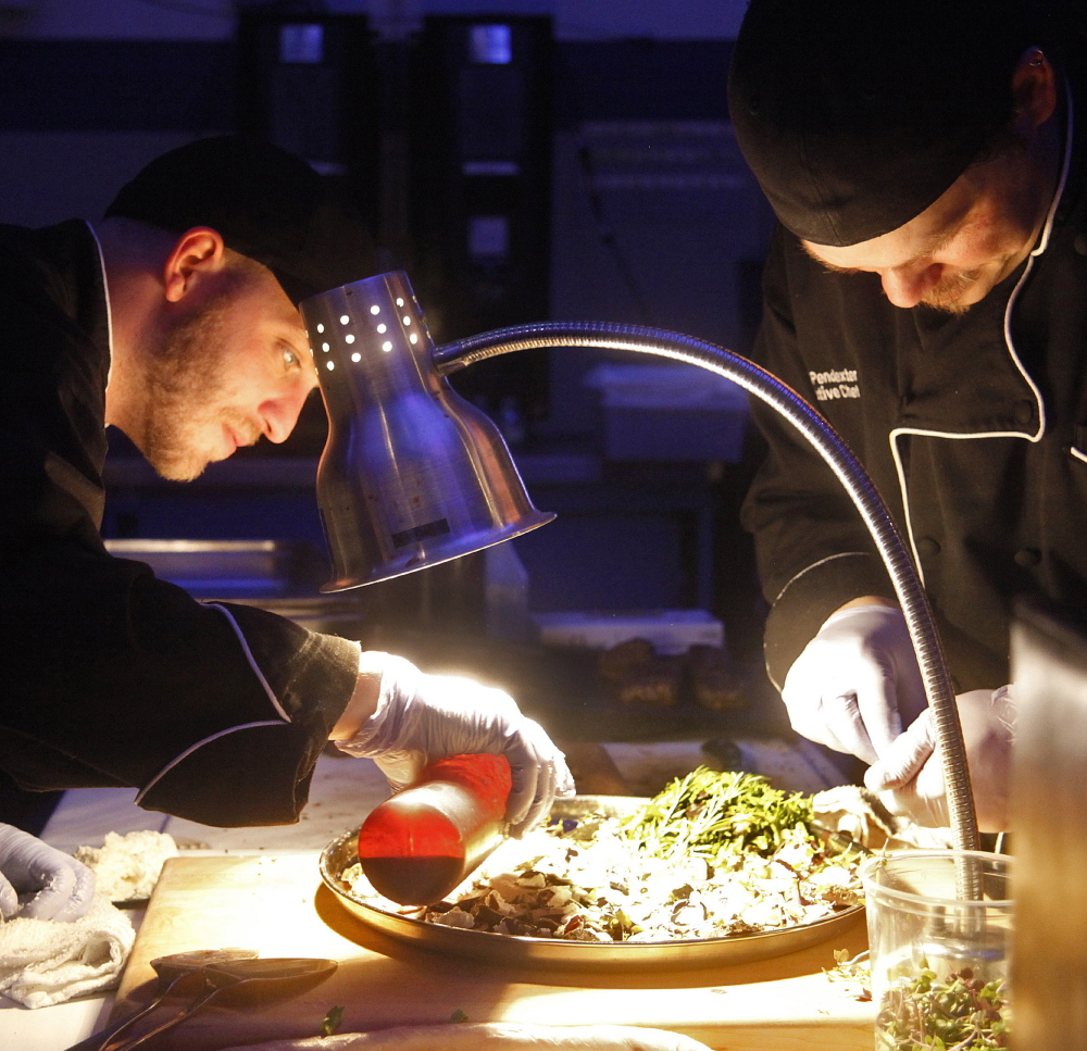 Joshua Alds and David Pendexter, sous and executive chefs, respectively, at the Brunswick Hotel & Tavern, prepare food at The Signature Event.