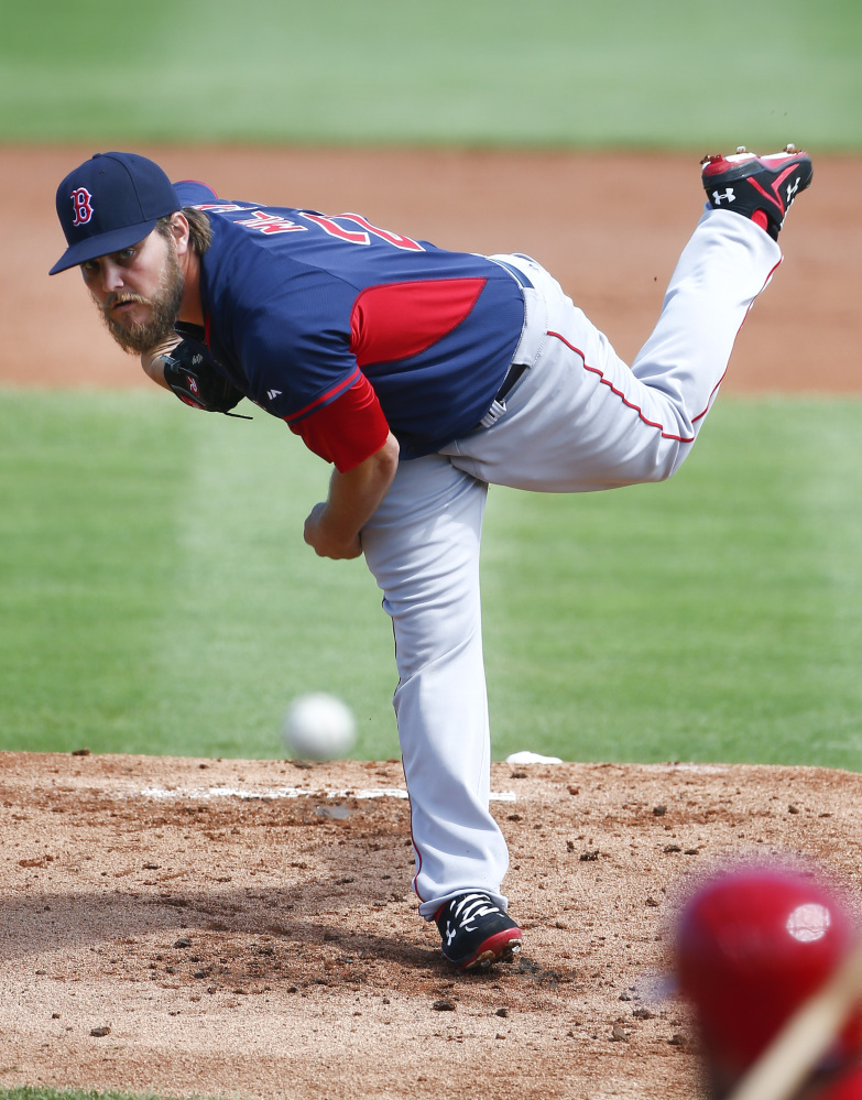 Boston Red Sox starting pitcher Wade Miley (20) works against the St. Louis Cardinals in the first inning of an exhibition spring training baseball game Monday, March 9, 2015, in Jupiter,  Fla. (AP Photo/John Bazemore)