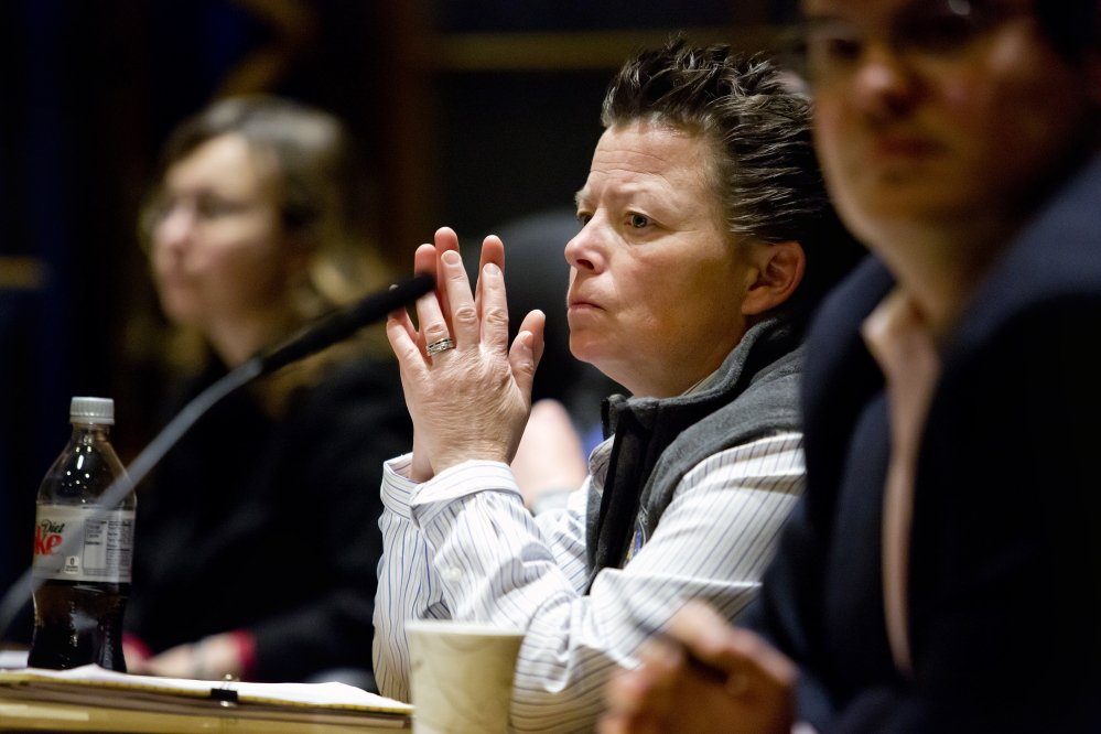 Tammy Manson, director of Portland's inspections division, waits to speak at a meeting of the Public Safety, Health and Human Services Committee as members discuss whether the city should overhaul its fire safety program Gabe Souza/Staff Photographer
