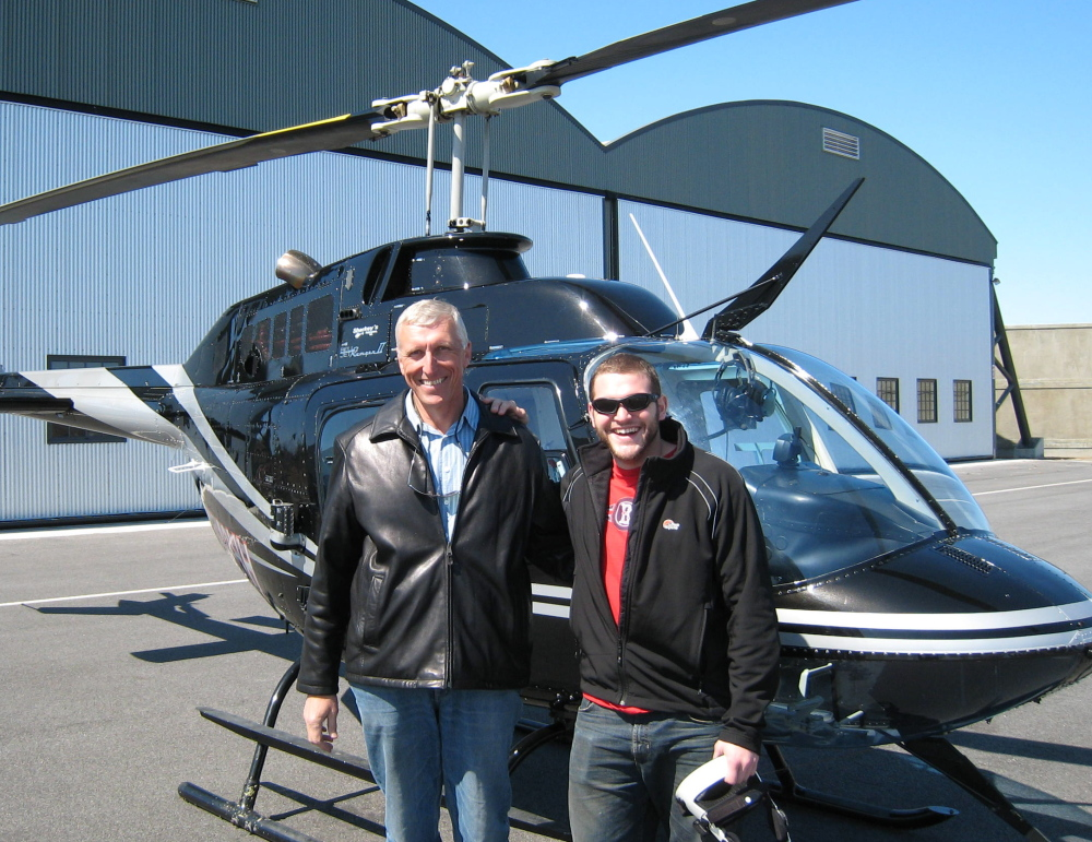 Michael Scarks, left, who died unexpectedly Thursday, had a passion for flying, said his son Stefan, also photographed here. The elder Scarks was an prominent real estate developer.