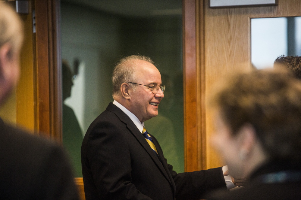 PORTLAND, ME - MARCH 11: New USM President Harvey Kesselman greets attendees of a press conference held at the Glickman library at USM in Portland, ME on Wednesday, March 11, 2015. (Photo by Whitney Hayward/Staff Photographer)