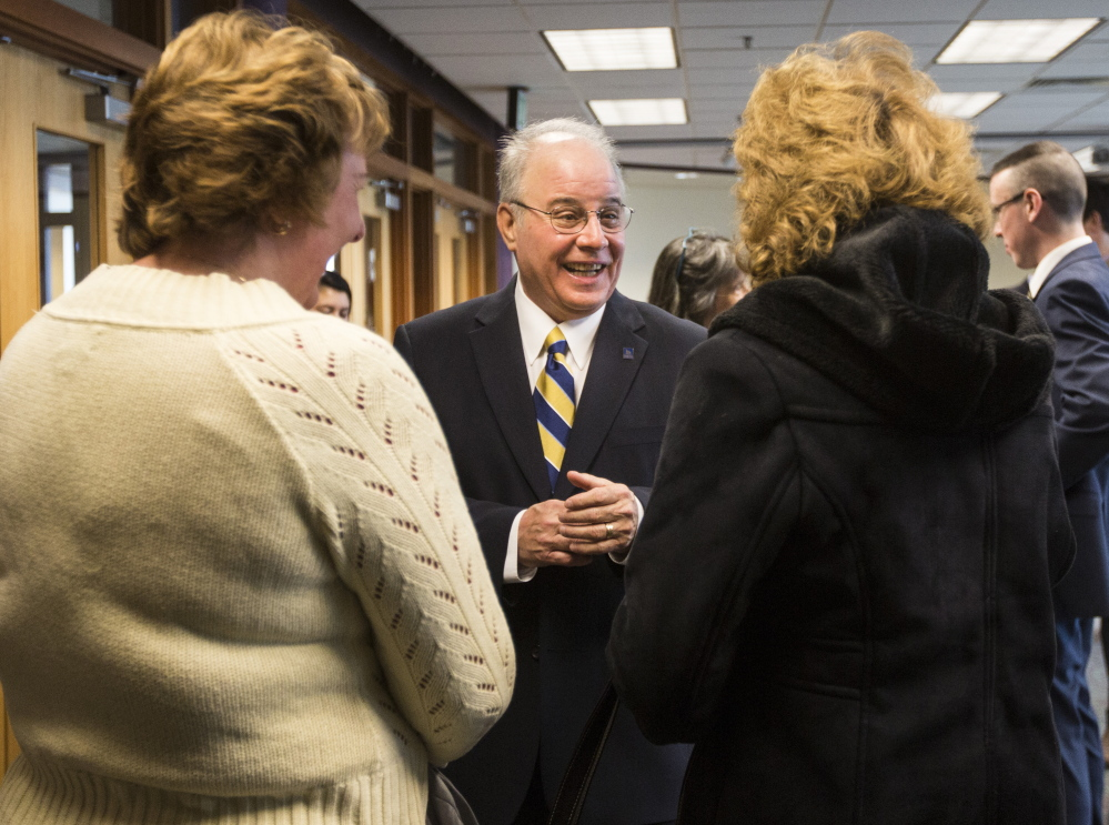 "Newly appointed USM President Harvey Kesselman greets people Wednesday at the Portland campus, where he was praised for his extensive resume. ""He has been on both sides of the union, on both sides of shared governance,"" said Faculty Senate President Jerry Lasala."