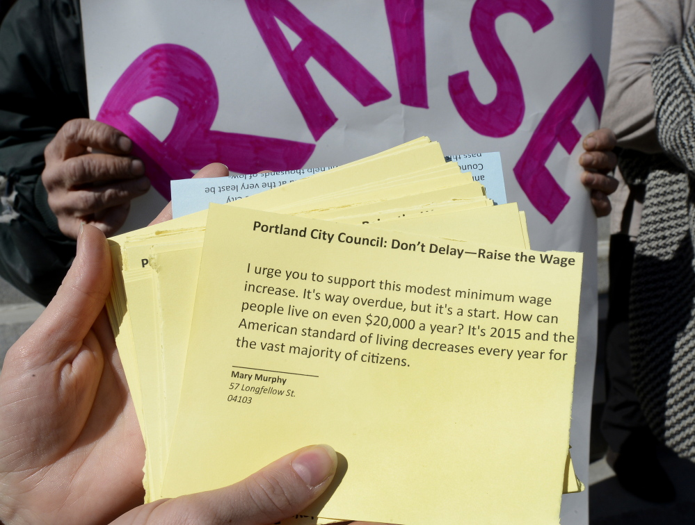 Postcard petitions delivered at Portland City Hall on Wednesday ask the city to take action on establishing a citywide minimum wage.