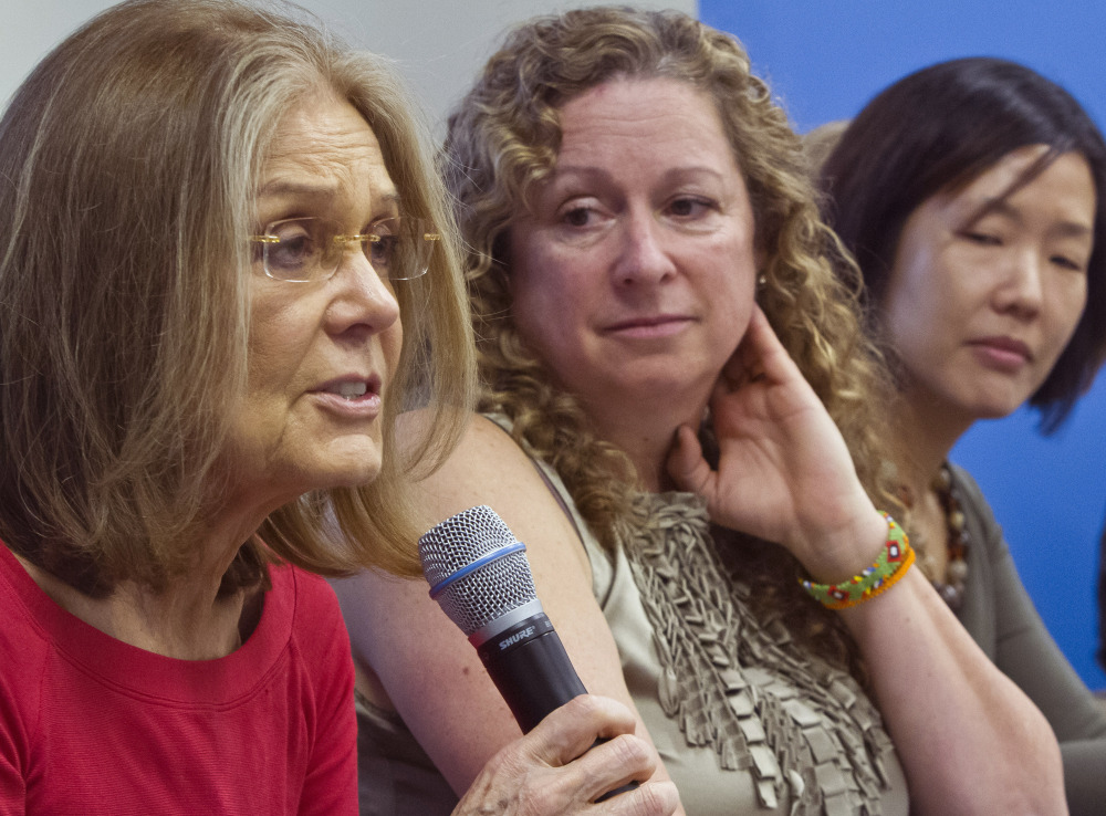 Gloria Steinem, left, holds a United Nations news conference Wednesday announcing plans to walk across the demilitarized zone.