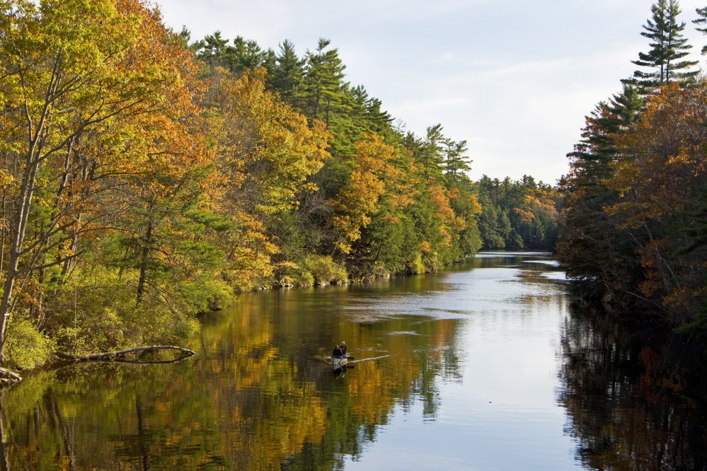 A couple canoes on the Saco River in Hollis in 2007. Land for Maine's Future helped the town buy this stretch of land to protect it from development. Gov. LePage has yet to release bond money for over two dozen other LMF projects approved by voters in 2010 and 2012.