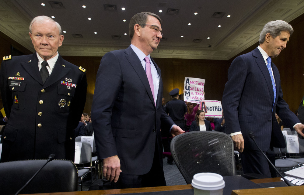 From left, Joint Chief Chairman Gen. Martin Dempsey, Defense Secretary Ash Carter, and Secretary of State John Kerry on Capitol Hill in Washington on Wednesday. The three testified on Islamic State militants before the Senate Foreign Relation Committee.