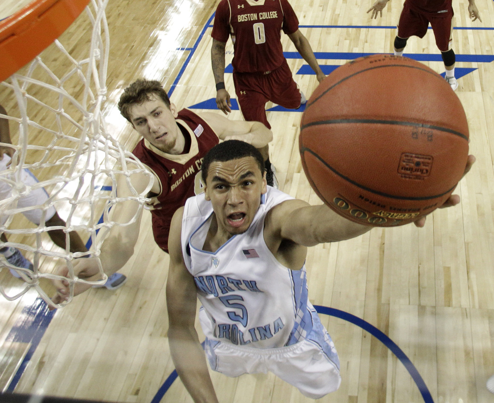 North Carolina's Marcus Paige drives past Boston College's Eddie Odio in Wednesday's second-round ACC tournament game in Greensboro, N.C. The Tar Heels advanced with an 81-63 win.