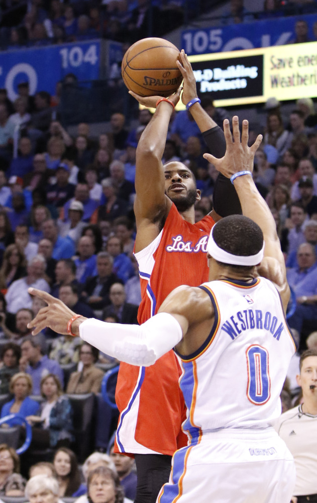 Chris Paul, who had 33 points for the Los Angeles Clippers, shoots over Russell Westbrook of the Oklahoma City Thunder during the Clippers' 120-108 victory.