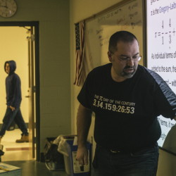"""Biddeford High School math teacher Jon Jacques instructs his calculus class while wearing a shirt with some of the numbers of pi written out. Jacques does parody songs for Pi Day, and has spoofed Queen's """"Bohemian Rhapsody"""" into """"Pi-Rational Rhapsody."""""""