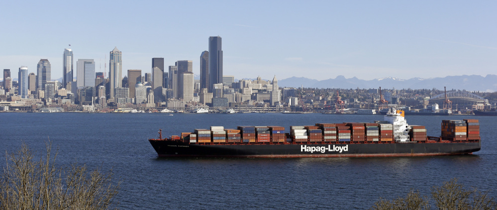 A container ship sits anchored in Elliott Bay in view of downtown Seattle. The United States is negotiating an ambitious trade agreement with 11 Pacific Rim countries that's meant to ease barriers to fast-growing Asia-Pacific markets and streamline customs rules. The Associated Press