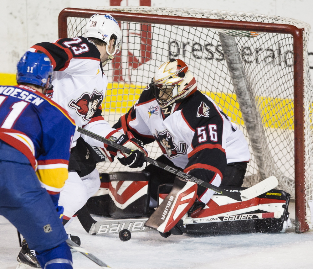 Portland goalie Mike McKenna makes a save against the Norfolk Admirals during the Pirates' 2-1 overtime win Friday at Cross Insurance Arena in Portland.