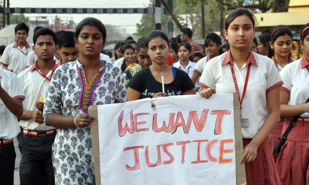 Students of Convent of Jesus and Mary School protest against the gang rape of a nun in her 70s by bandits when she tried to prevent them from robbing a Christian school.