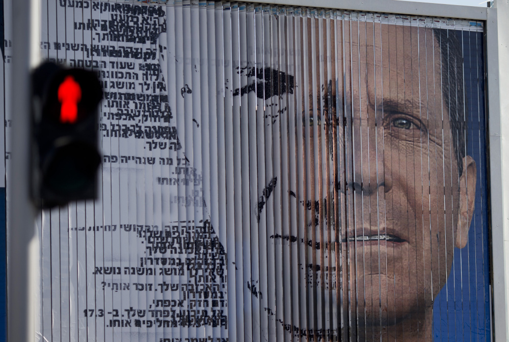 An election campaign billboard shifts between images of Isaac Herzog, leader of the Labor Party, right, and Israel's Prime Minister Benjamin Netanyahu and leader of the Likud Party, in Tel Aviv, Israel.