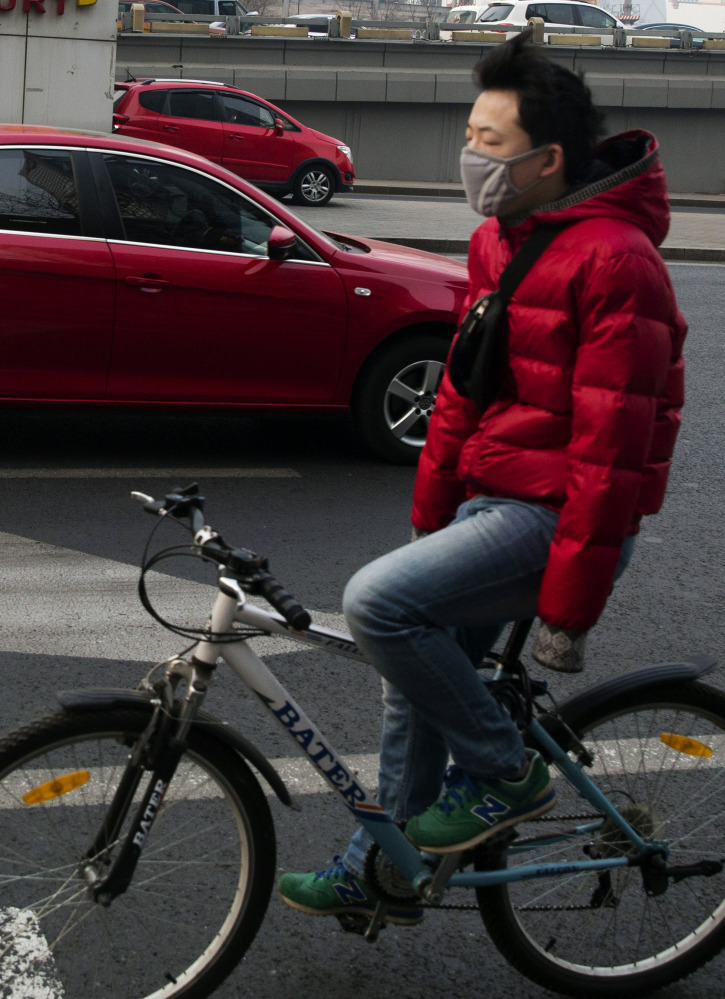Just breathing in Beijing can be hazardous to one's health, especially for people doing a strenuous activity such as bicycling in the busy streets of one of China's smog-ridden metropolitan areas.