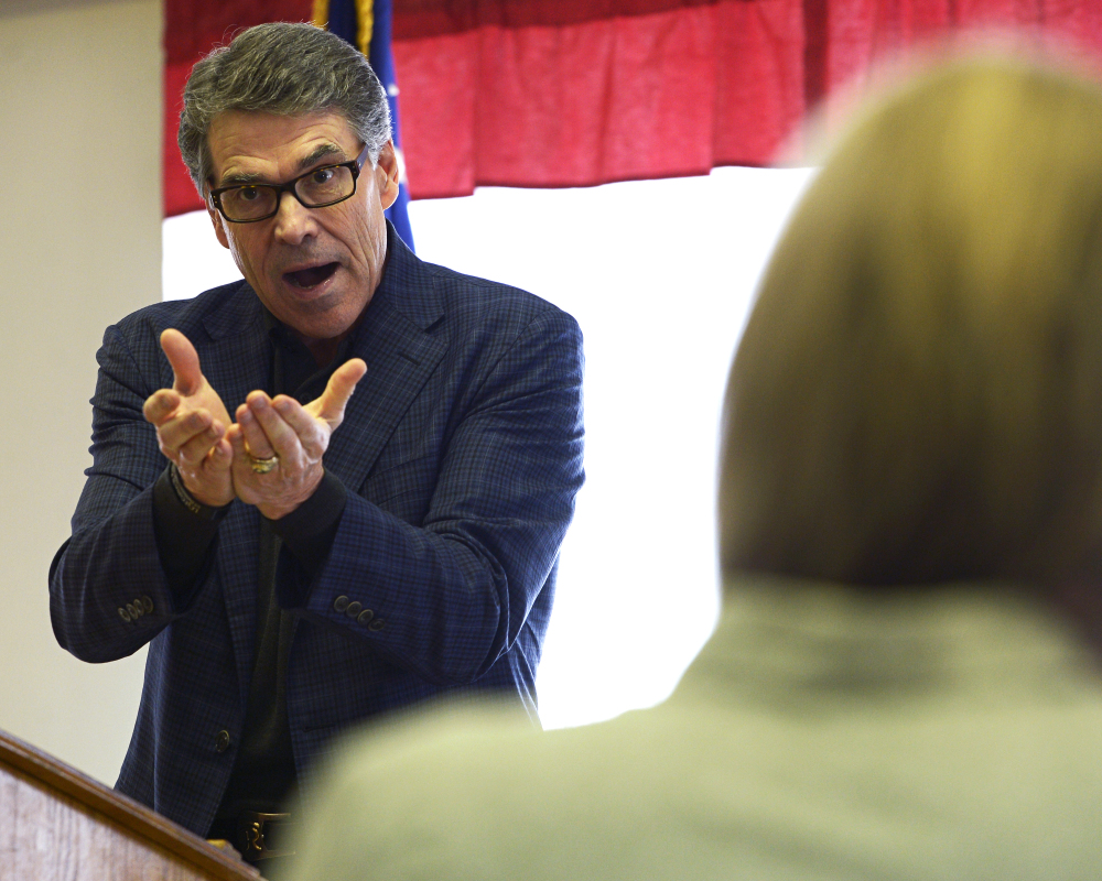 Former Texas Gov. Rick Perry speaks at a town hall meeting at VFW Post 816 in Littleton, N.H., on Friday.
