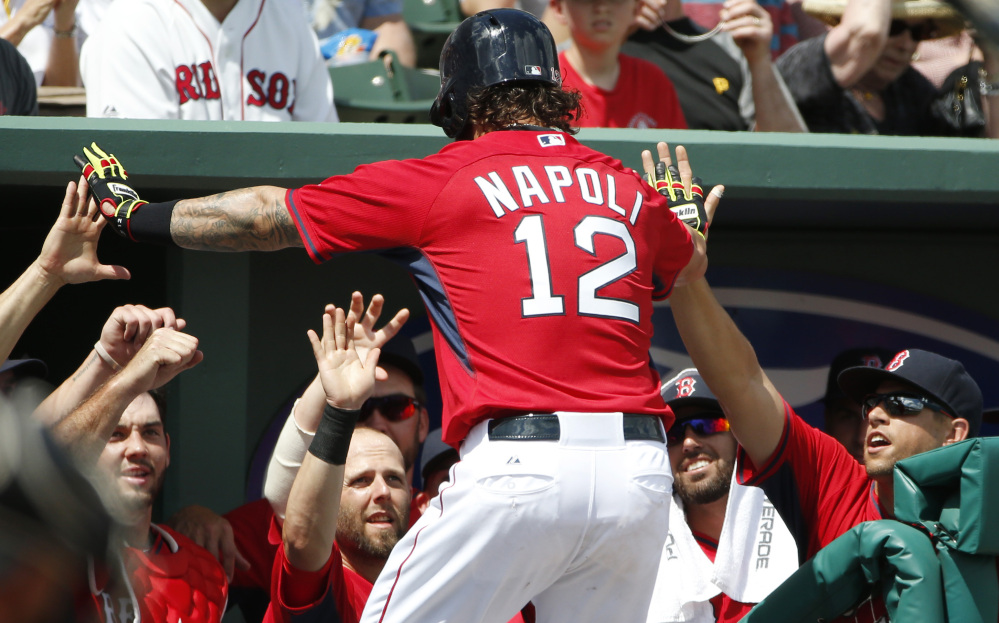Mike Napoli is congratulated in the dugout after a solo home run in the fourth inning Saturday. Napoli, who had an eight-hour surgery for sleep apnea in the offseason, homered twice.