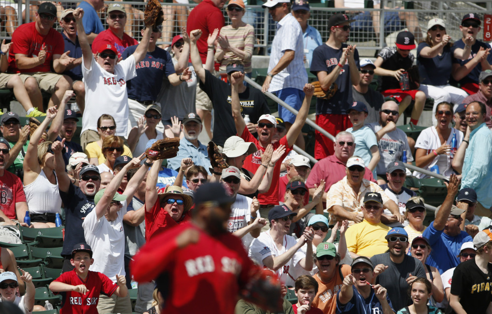 Red Sox fans give new third baseman Pablo Sandoval a big cheer after Sandoval threw out Pittsburgh's Tony Sanchez in the fourth inning of Boston's 5-3 loss Saturday in Fort Myers, Florida.