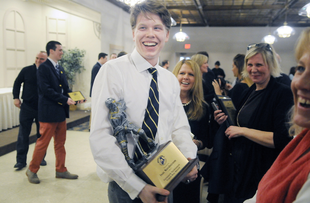 Falmouth's Isac Nordstrom is all smiles after winning the Travis Roy Award Sunday at a ceremony in Lewiston.