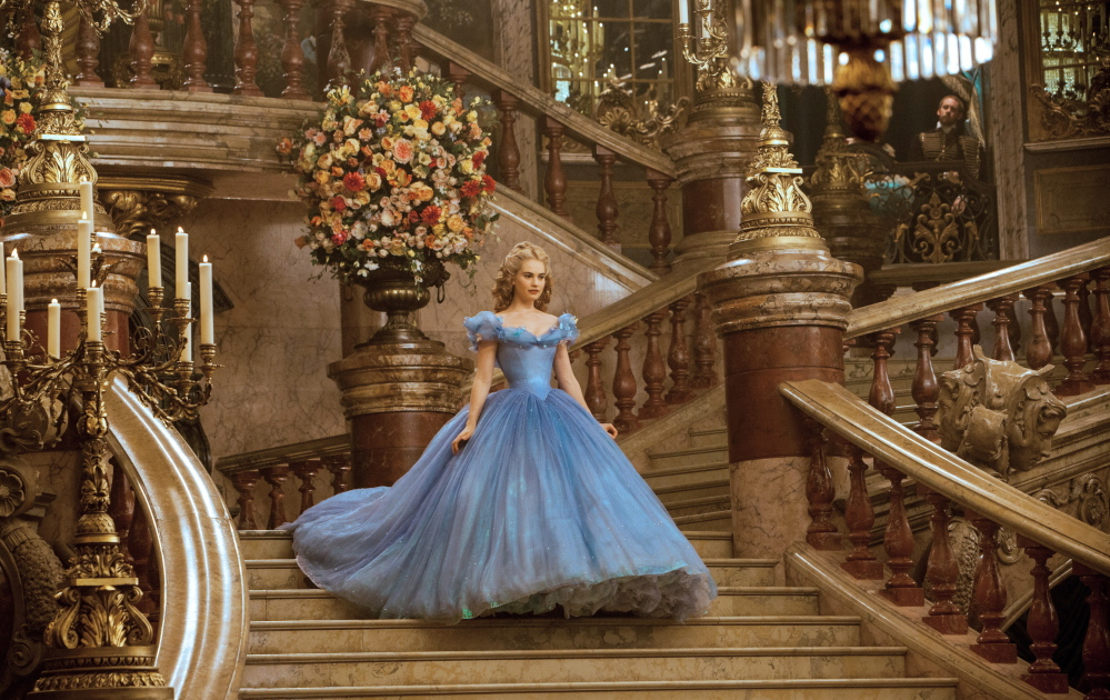 "Lily James plays Cinderella in Disney's live-action feature film inspired by the classic fairy tale, ""Cinderella."""