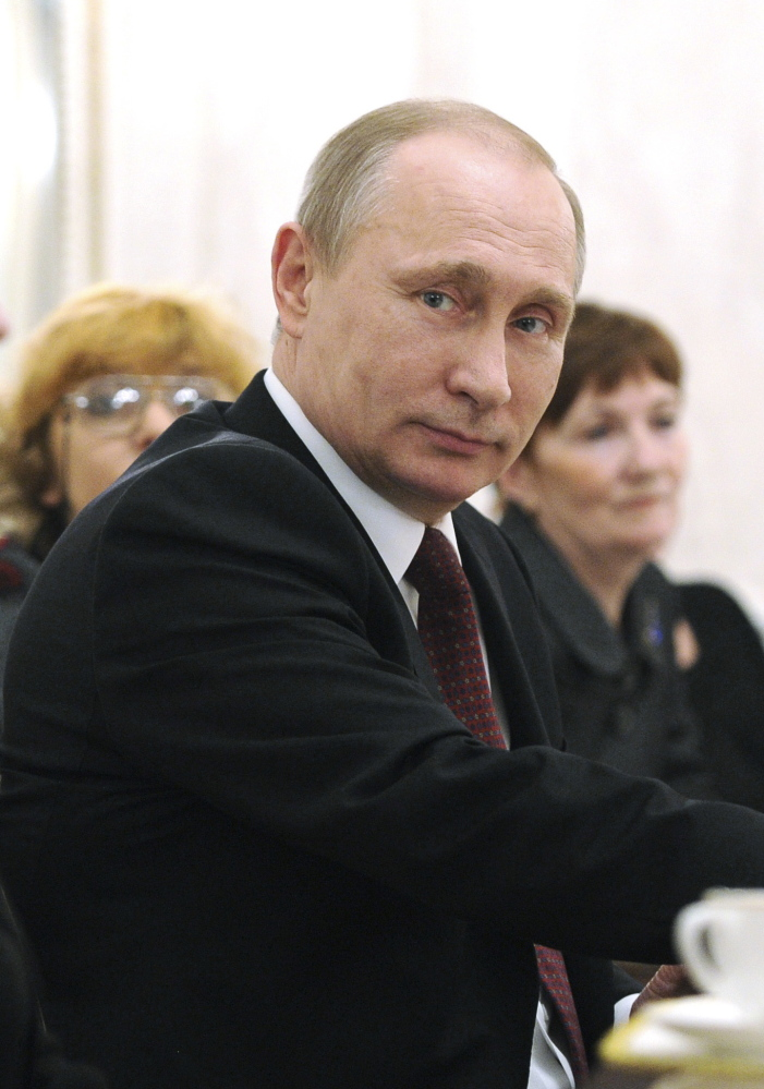 Russian President Vladimir Putin says in a documentary that aired Sunday that the Russian military had been prepared to put nuclear weapons on alert if necessary over the Crimean situation.
