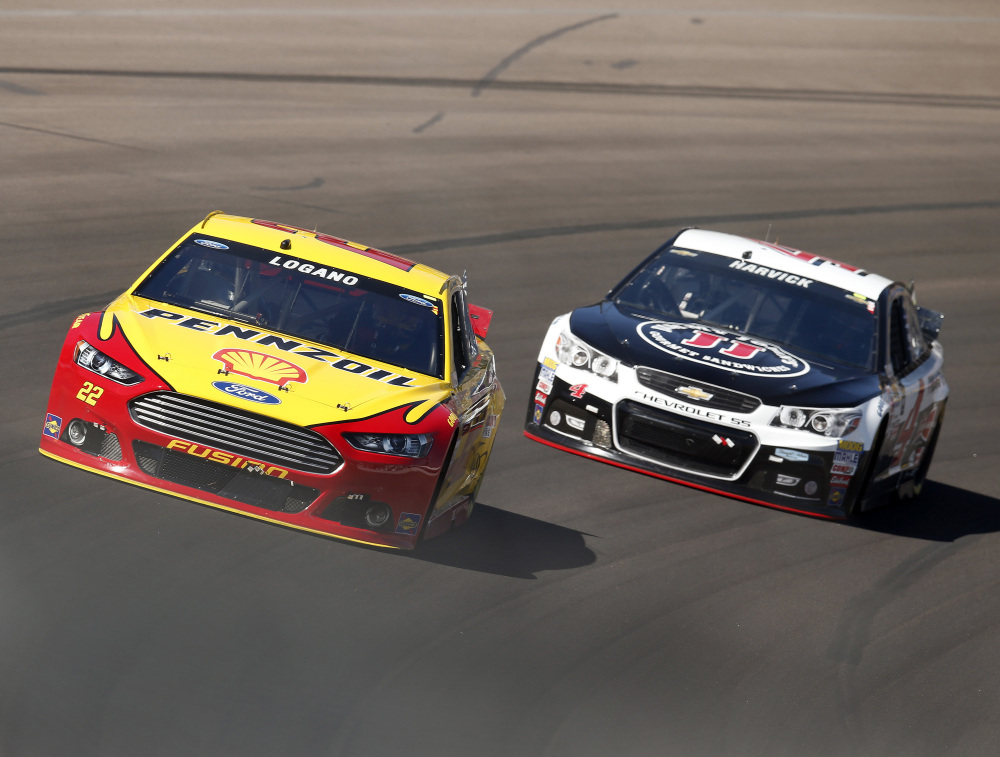 Joey Logano, left, leads Kevin Harvick early, but Harvick did what he often does at Phoenix International Speedway, he took over the lead and won for the fourth straight race at the track Sunday.