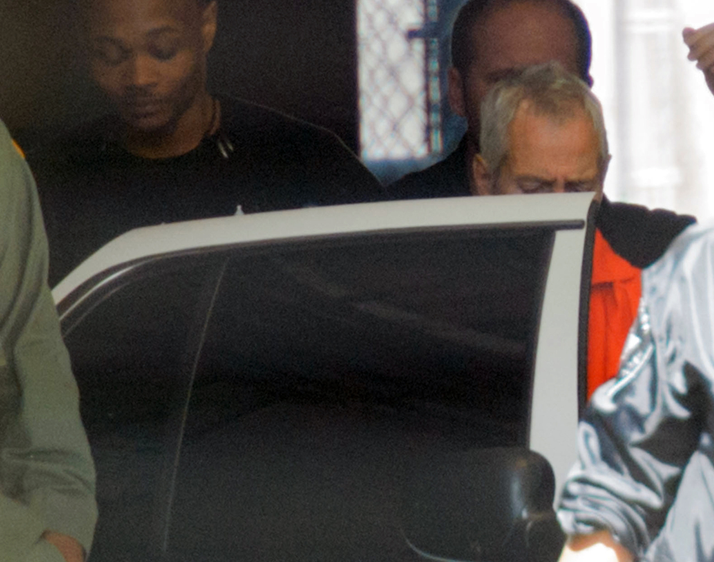 "Robert Durst is escorted from Orleans Parish Criminal District Court in New Orleans on Monday. Durst, a millionaire from one of America's wealthiest families, agreed Monday to return to Los Angeles to face a 15-year-old murder charge after muttering that he ""killed them all"" in a documentary about his links to three sensational killings."