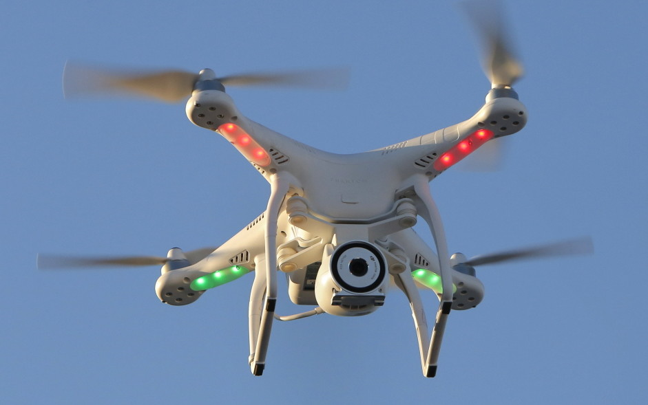 Steve Girard of Gorham takes aerial photos and videos using his drone and was asked by a local FAA administrator to take down his website of aerial images. The incident highlights the federal agency's inability to keep pace with the demands of the small-business community.