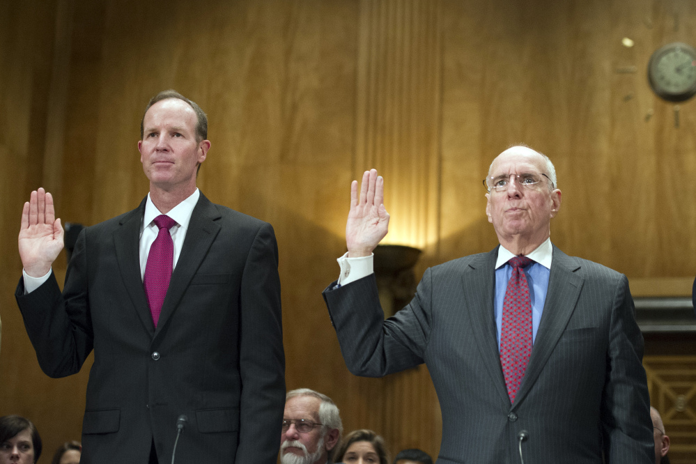 Sean Brune, senior adviser to the deputy commissioner for Budget, Finance, Quality and Management, U.S. Social Security Administration, left, and Patrick O'Carroll Jr., inspector general, U.S. Social Security Administration, swear in to testify about the Death Master File.
