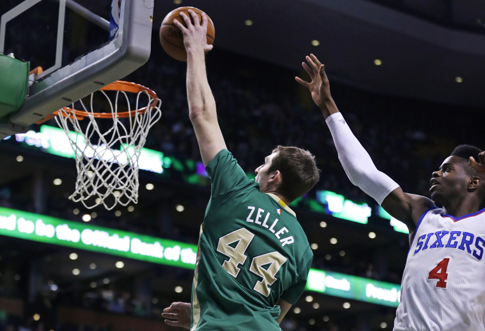 Boston Celtics center Tyler Zeller drives past Philadelphia 76ers center Nerlens Noel for a dunk during the first quarter of Monday night's game in Boston. Zeller finished the game with a career-high 26 points as the Celtics won easily.