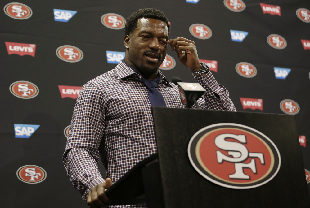 San Francisco 49ers linebacker Patrick Willis wipes his eye as he speaks at a news conference at the team's NFL football facility in Santa Clara, Tuesday.